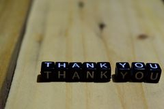 Critical written on wooden blocks. Inspiration and motivation concepts.Thank you written on wooden blocks. Inspiration and motivat royalty free stock photography