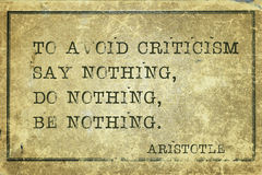 Criticism print. To avoid criticism say nothing - ancient Greek philosopher Aristotle quote printed on grunge vintage cardboard Stock Images
