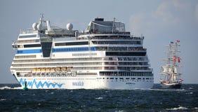 Criuse ship and sailing ship at Hansesail 2014 Royalty Free Stock Photography
