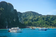 Criuse ships in Koh Phi Phi. Criuse ships at Koh Phi Phi shores with mountains in the background Stock Photos