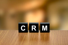CRM or Customer relationship management on black block Royalty Free Stock Photography