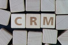CRM, Customer Relationship Management, loyalty program, repeat p. Urchase frequency concept, cube wooden block with alphabet combine the word abbreviation CRM on stock photos