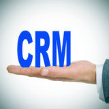 CRM, Customer Relationship Management. A man holding the acronym CRM for Customer Relationship Management Royalty Free Stock Photography