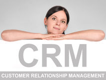 CRM icon. Woman leans on a board with a CRM icon Stock Image