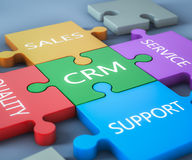 CRM jigsaw. Render of a jigsaw with business text written on it stock illustration