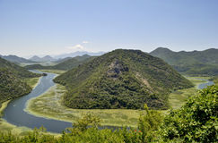 Crnojevica River, Montenegro. Crnojevica River flows into the Skadar lake. It flows through the territory of the Skadar Lake national park. View from top of Royalty Free Stock Photos