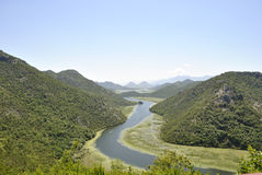 Crnojevica River, Montenegro. Crnojevica River flows into the Skadar lake. It flows through the territory of the Skadar Lake national park. View from top of Stock Photography