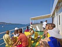 Croacia, turistas en un transbordador a las islas Imagen de archivo libre de regalías