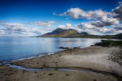 Croagh Patrick holly mountain blue water and cloudy blue sky stock image