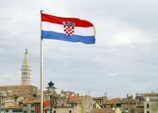 Croatia. N flag over the roof tops of the old town Rovinj Stock Photo