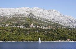 Croatia. Coastline in Croatia and a sailing boat Stock Photo