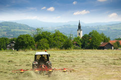 Croatia. Landscape view from country in Croatia, with tractor in a field Stock Photo