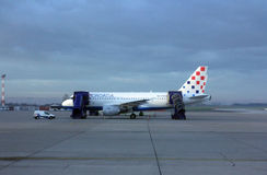 Croatia Aerlines A319 serviced by the ground crew in Zagreb. Croatia Aerlines A319 serviced by the ground crew on November 04, 2012 in Zagreb, Croatia. Croatia Stock Photography