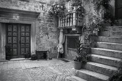 Croatia black white. Croatia - Trogir in Dalmatia (UNESCO World Heritage Site). Old town detail. Black and white tone - retro monochrome color style Royalty Free Stock Photo