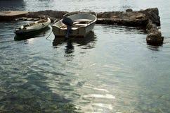 Croatia, boats moored at pier, backlight Royalty Free Stock Image