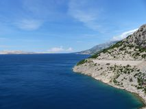 Croatia Coastline with road. Croatia Coastline in Adratic sea with blue sea and the road on the coast with campervan Royalty Free Stock Photo