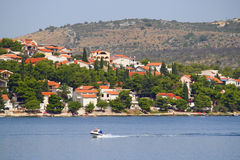 Croatia cooast. Bay in Croatia, with boat and bungalows Royalty Free Stock Image
