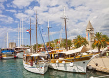 Croatia, cruise ships moored at Trogir quayside. TROGIR, CROATIA - AUGUST 16, 2014. Touristic cruise ships are moored on the quayside of Trogir sea promenade Royalty Free Stock Image
