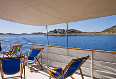 Croatia, cruising along Kornati islands. Deck of a ship cruising along Kornati islands. Most of the islands of the Kornati archipelago are deserted, but some Stock Images