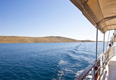 Croatia, cruising along Kornati islands. Ship cruises to Kornati archipelago. Most of the islands of the Kornati archipelago are deserted, but some small houses Stock Photos
