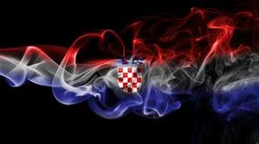 Croatia flag smoke. Isolated on black background stock image