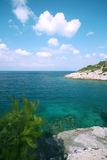 Croatia, island of Hvar, beautiful seascape and beach. Island of Hvar, Dalmatia, Croatia, beautiful seascape, with a crystal blue sea and beach on a sunny day Stock Images