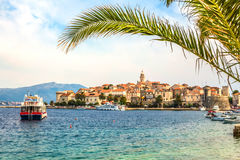 Croatia - island Korcula. The historic town of Korcula and palm leaf. Tourist attractions and sights Dalmatian. The island of Korcula and the port city of Stock Images