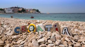 Croatia name on stones and dalmatian town Stock Image