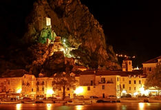 Croatia - Omis and old fort Mirabela at night. The very role of the fort  Mirabela was the vanguard of the enemy Stock Photos