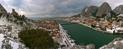 Croatia - Omis at snow. Omis is a city that lies at the mouth of the Cetina River into the Adriatic Sea. It is surrounded by steep mountain cliffs Babnjaca. This stock photography