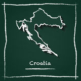 Croatia outline vector map hand drawn with chalk. Croatia outline vector map hand drawn with chalk on a green blackboard. Chalkboard scribble in childish style Royalty Free Stock Images