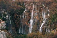 Autum colors and waterfalls of Plitvice National Park in Croatia. Croatia. Plitvice Lakes. Large waterfall surrounded by autumn forest Royalty Free Stock Photography