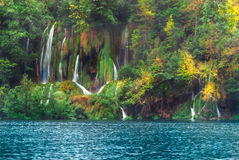 Croatia. Plitvice Lakes. Waterfall on a hillside near the lake with autumn trees Stock Images
