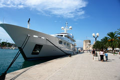Croatia, a ship moored, people walking nearby. royalty free stock images
