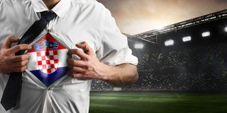 Croatia soccer or football supporter showing flag. Under his business shirt on stadium stock photography