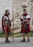Re-enactors dressed as Roman Legionnaires, wait to pose with Tourists at the gates to the Diocletian Palace stock images