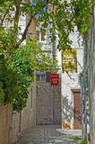 Croatia, Trogir - old town street with hotel signs Royalty Free Stock Images