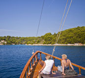 Croatia, two girls enjoy the view of Solta island from the prow Stock Photos