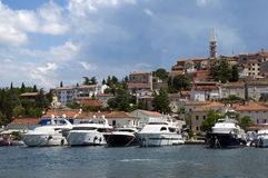 Croatia -  Vrsar - Boats and town on port Stock Image