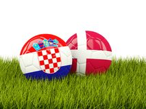 Croatia vs Denmark. Soccer concept. Footballs with flags on gree Royalty Free Stock Image