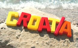 Croatia word and sea wave Stock Images