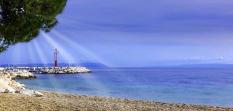 Croatian beach and Adriatic Sea with visible sun rays - Tucepi, Makarska Riviera, Croatia. Croatian beach and Adriatic Sea with visible sun rays in Tucepi royalty free stock images