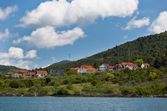 Croatian coastline with a village view from the sea Royalty Free Stock Photo