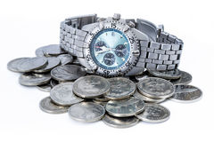 Croatian coins with wristwatch. Croatian metal coins. Mostly coins worth two Kunas with silver wristwatch Royalty Free Stock Images