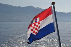 Croatian national flag flying at windy day Stock Photos