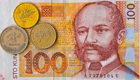 Croatian currency note 100 Kuna banknote and coins macro. Front side. Portrait of Ban Ivan Mazuranic stock images