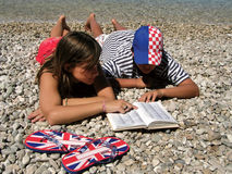 Croatian-England dictionary. Croatian boy and England girl in love with dictionaries Stock Photography