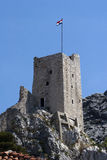 Croatian flag on fortress Mirabella Peovica above the town Omis in Croatia Stock Photography