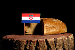 Croatian flag on a stump with bread Royalty Free Stock Images