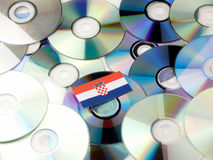 Croatian flag on top of CD and DVD pile isolated on white Royalty Free Stock Photo